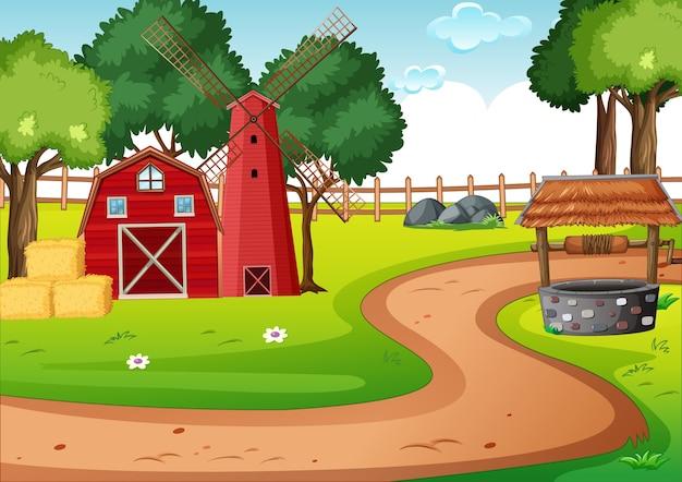 Fienile e widmill nella scena della fattoria Vettore gratuito