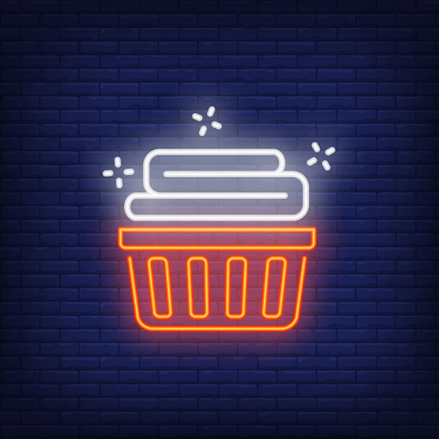 Basket with clean linen neon sign Free Vector