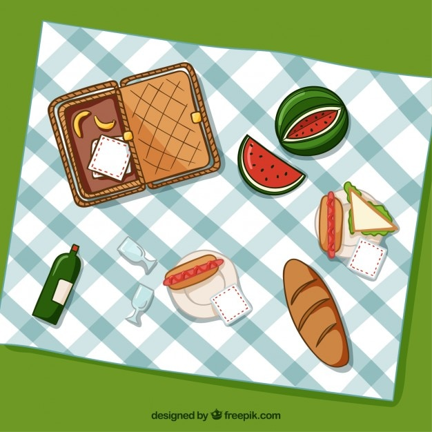 Basket with picnic elements and food in top\ view