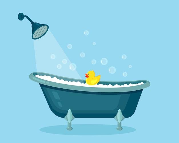 泡の泡でいっぱいの浴槽。バスルームのインテリア。シャワーの蛇口、石鹸、ゴム製のアヒル Premiumベクター