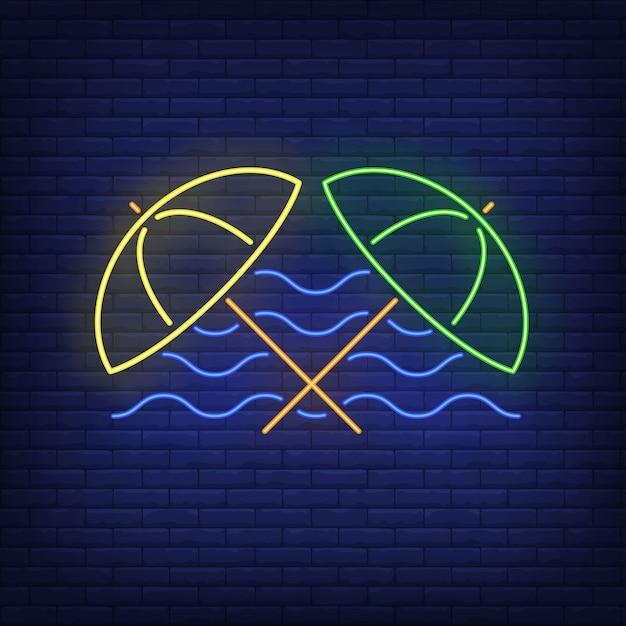 Beach umbrellas and sea waves neon sign. summer, holiday, vacation, resort. Free Vector