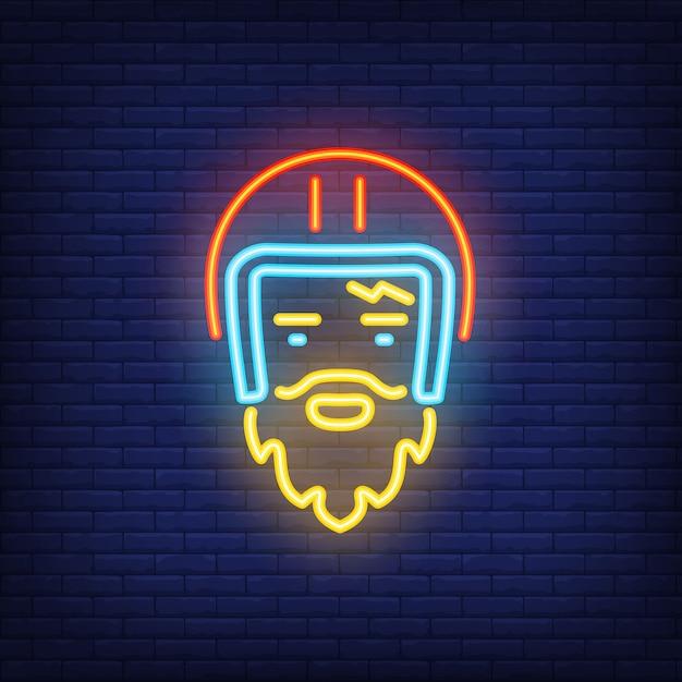 Bearded biker wearing helmet on brick background. neon style illustration. Free Vector