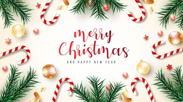 Красивая и реалистичная рождественская открытка с зелеными ветками и разными рождественскими элементами Бесплатные векторы