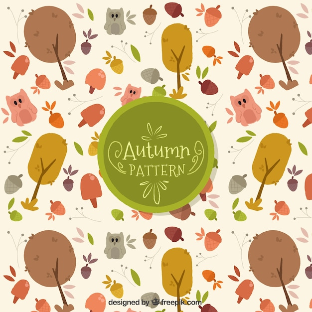 Beautiful autumnal pattern with hand drawn trees Free Vector