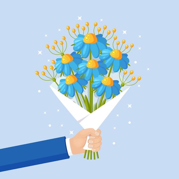 Красивый букет d на фоне. букет цветов для подарка в руке. для поздравительной открытки Premium векторы