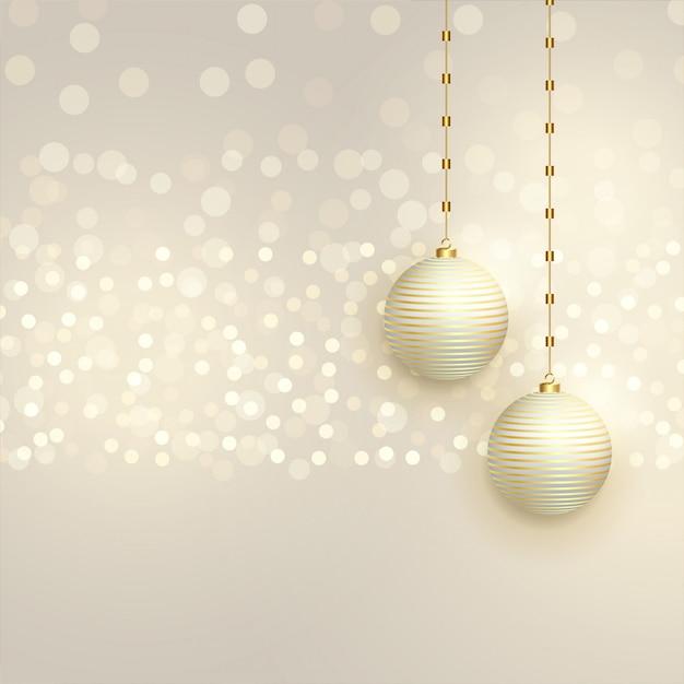 Beautiful christmas balls on bokeh background Free Vector