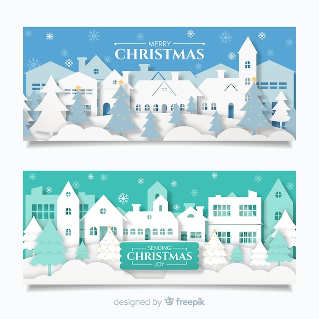 Beautiful christmas town banners in paper style Free Vector