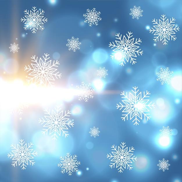 I bei fiocchi di neve di inverno di natale e il bokeh accende il fondo Vettore gratuito
