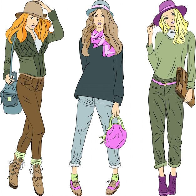 Beautiful fashion girls top models in hats and pants Premium Vector