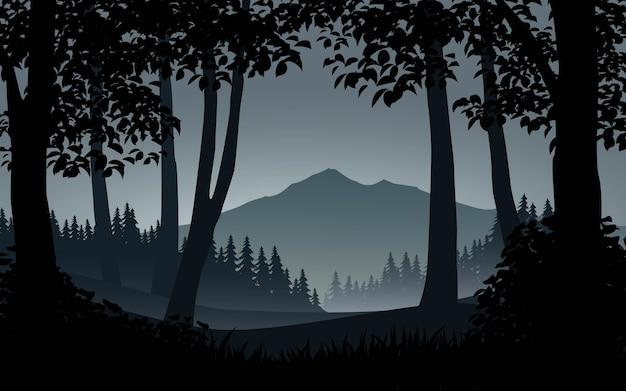 山と美しい森のシルエットの風景 Premiumベクター
