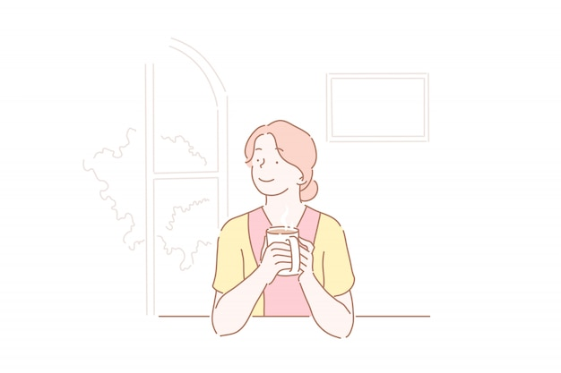 Beautiful girl drinking a cup of coffee at kitchen. Premium Vector
