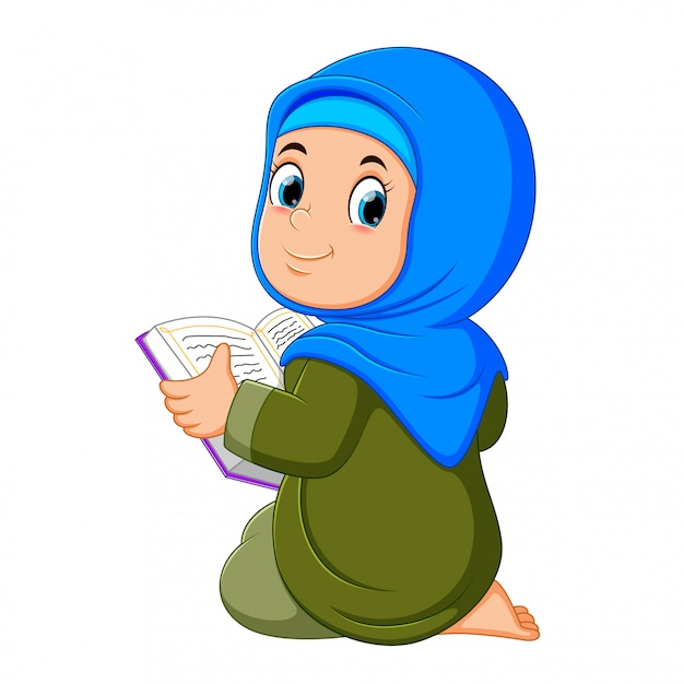 The beautiful girl with blue veil is holding al quran Premium Vector