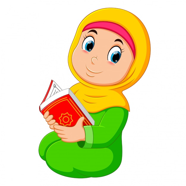 The beautiful girl with yellow veil is holding al quran Premium Vector