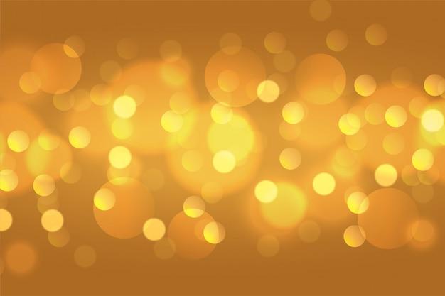 Beautiful golden bokeh lights background wallpaper design Free Vector