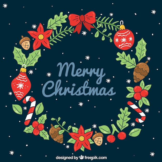Beautiful hand drawn christmas wreath Free Vector