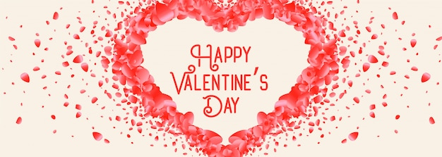 Beautiful heart made with rose petal valentine day card Free Vector