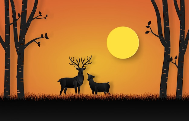 Beautiful horned deer in the forest with family surrounded by trees on sunset background in paper cut design. Premium Vector