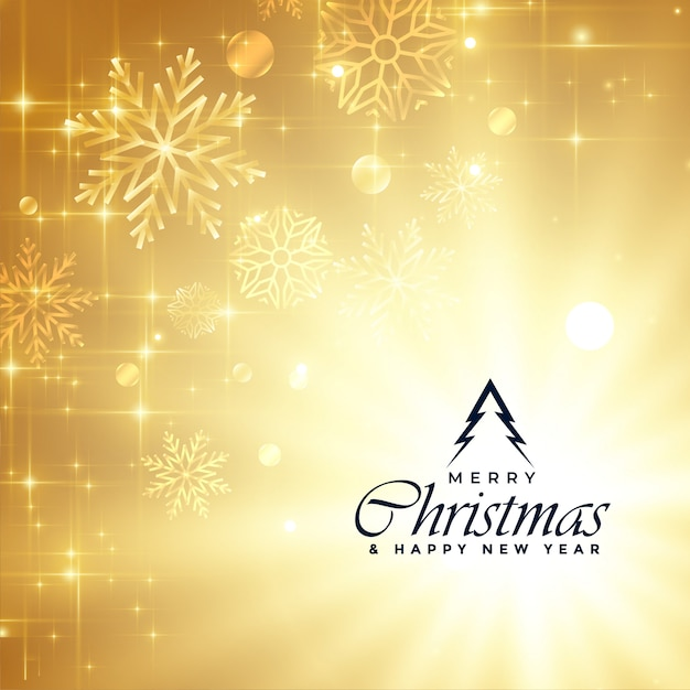 Beautiful merry christmas golden sparkles greeting Free Vector