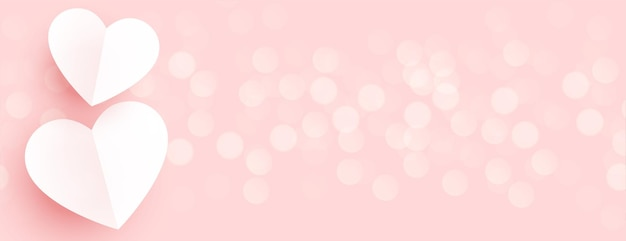 Beautiful paper hearts on pink bokeh banner Free Vector