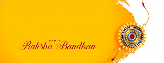 Beautiful raksha bandhan banner with golden rakhi Free Vector