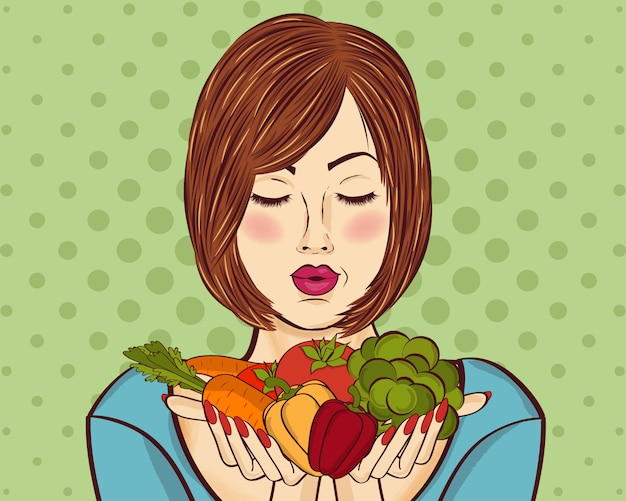 Beautiful red-haired lady with vegetables in his hands Premium Vector