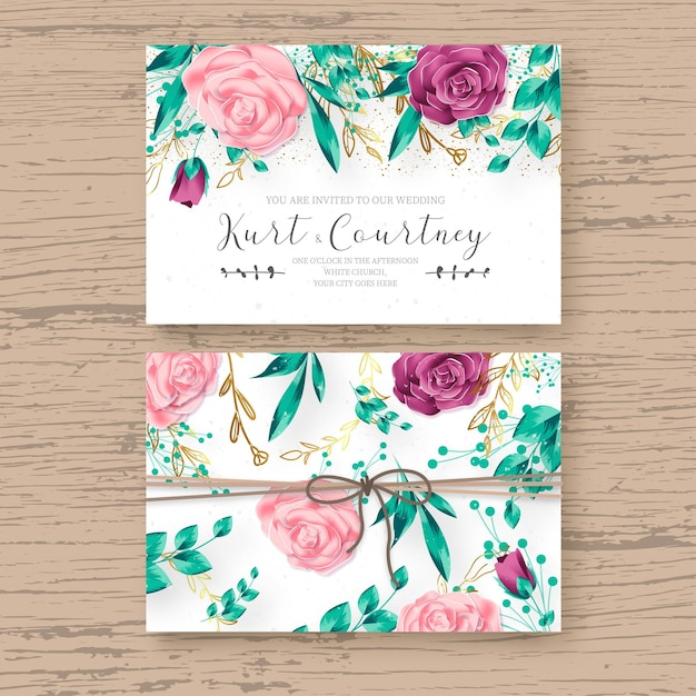 Beautiful wedding card template with realistic floral frame Free Vector