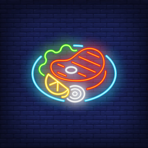 Beef steak with vegetables on dish neon sign Free Vector