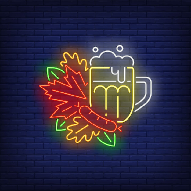 Beer mug with autumn leaves neon sign. Free Vector