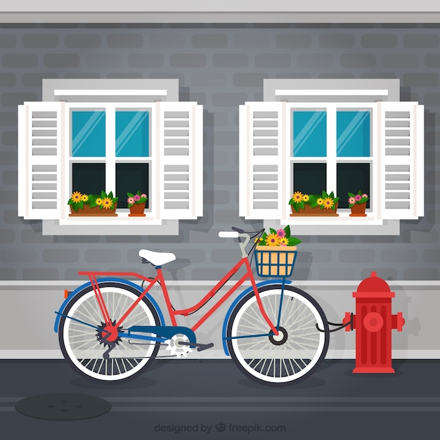 Bicycle in front of a facade background Free Vector