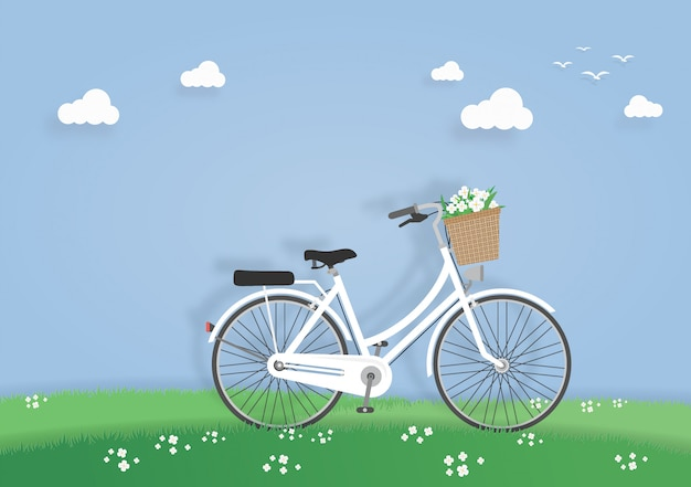 Bicycle in the meadow or garden Premium Vector