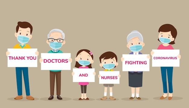 Большая семья держит баннеры для благодарных врачей и медсестер Premium векторы