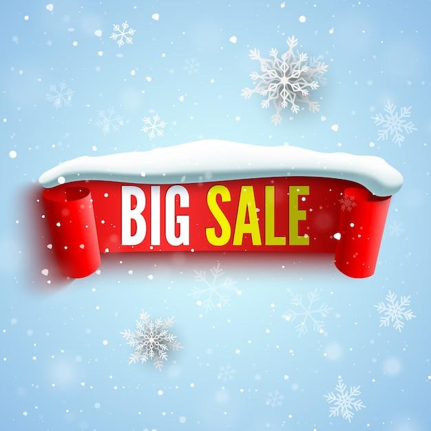 赤いリボン、スノーキャップ、雪片の大きなセールバナー。 Premiumベクター