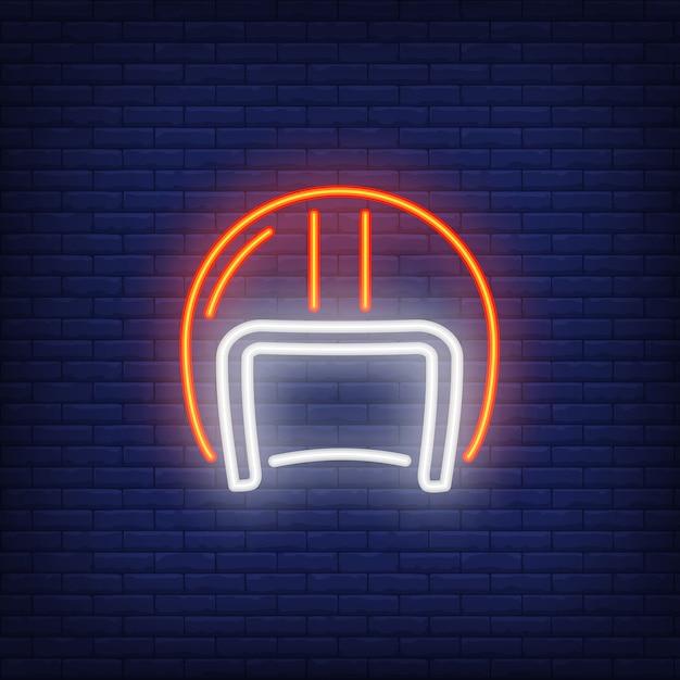 Biker helmet on brick background. neon style illustration. Free Vector