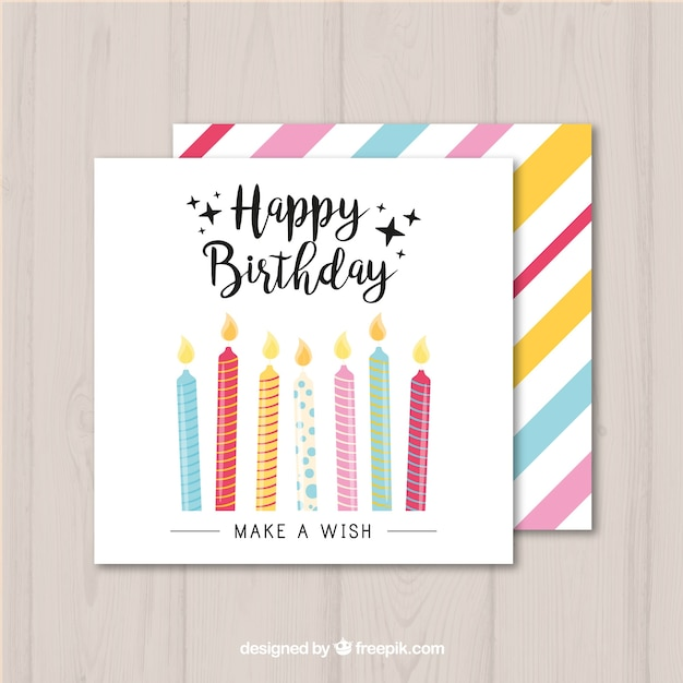 Birthday card with colorful candles Free Vector