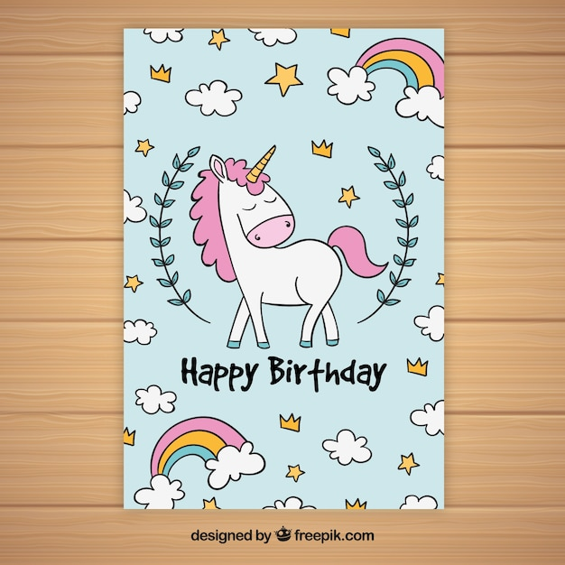 Birthday card with unicorn and hand drawn clouds Free Vector