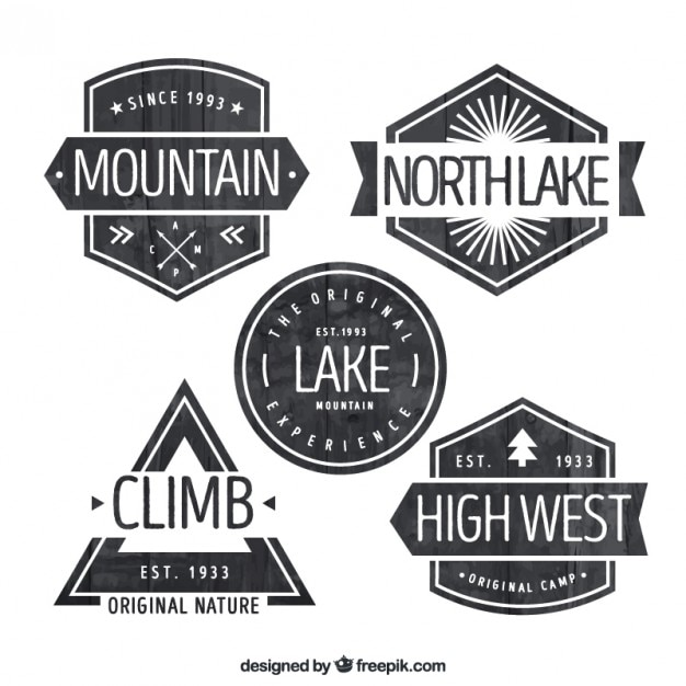 Black and white adventure badges