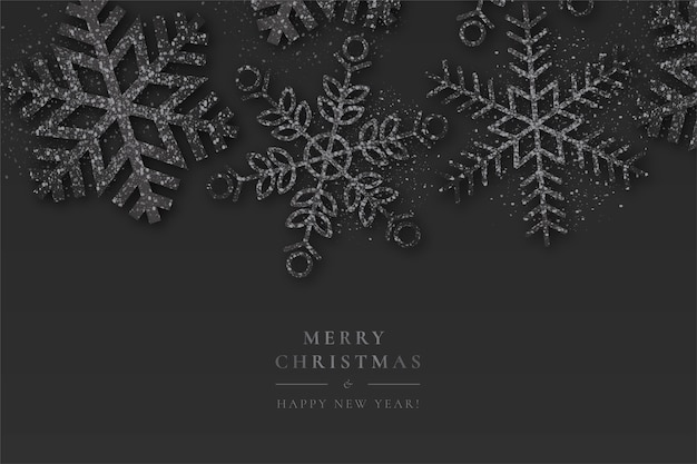 Black christmas background with sparkling snowflakes Free Vector