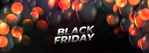 Black friday event banner with flying balloons Free Vector