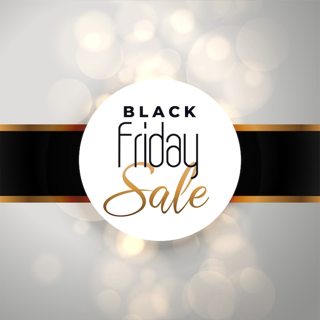 Black friday sale background with bokeh effect Free Vector