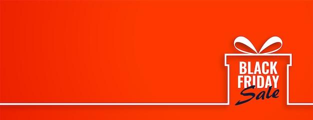 Black friday sale gift on orange web banner Free Vector
