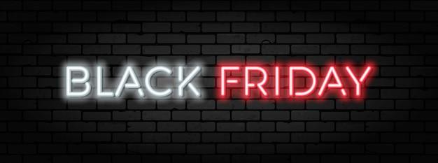 ブラックフライデーセールネオンバナー。ブリックウォールテクスチャのブラックフライデーセールの看板。輝く白と赤のネオン文字。リアルなイラスト Premiumベクター