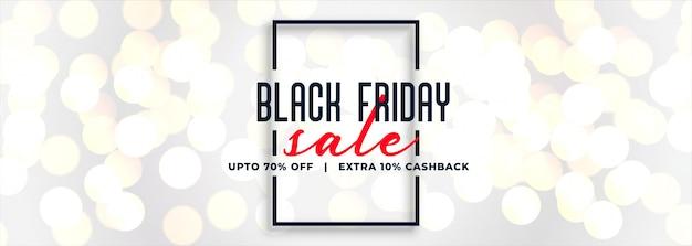 Black friday white sale bokeh banner Free Vector
