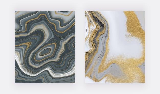 Black and golden glitter ink painting liquid marble texture. Premium Vector