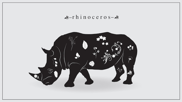Black rhinoceros with white flowers and plants. Premium Vector