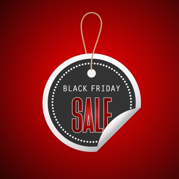 Black round sticker on red background for black friday