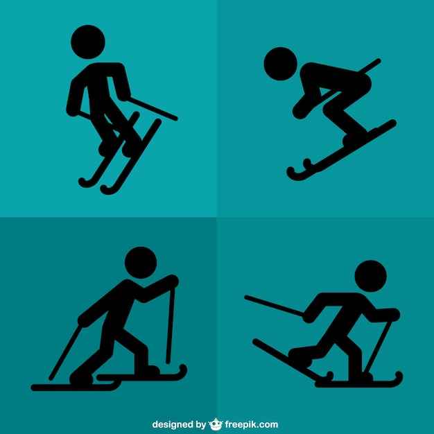 Black silhouettes skiing