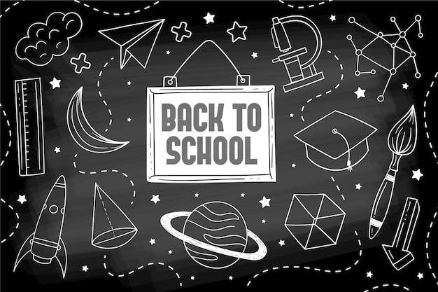 Lavagna torna a scuola sfondo con illustrazioni Vettore gratuito