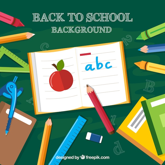 Blackboard background with crayons and other school elements