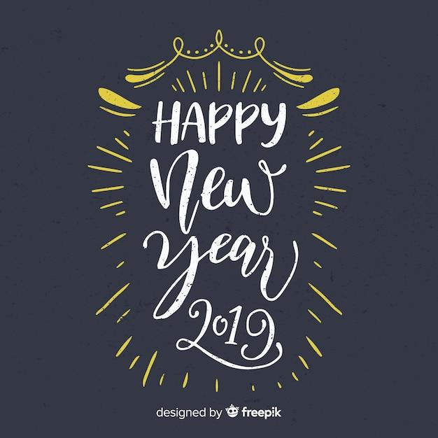 Blackboard new year background Free Vector