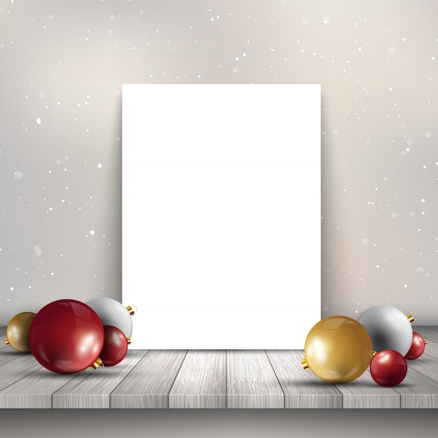 Blank canvas on wooden table with Christmas baubles